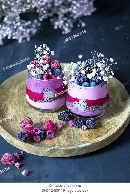 Smoothies (strawberries, raspberries, blueberries) with dragon fruit and chocolate muesli