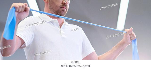 Man using resistance band