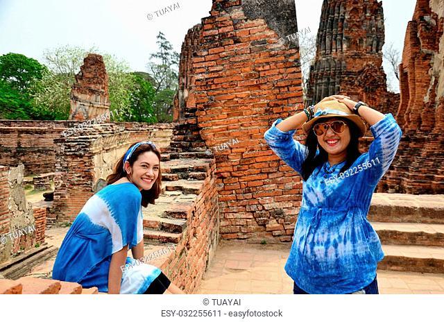 Thai women portrait at ancient building at Wat Mahathat in Ayutthaya, Thailand