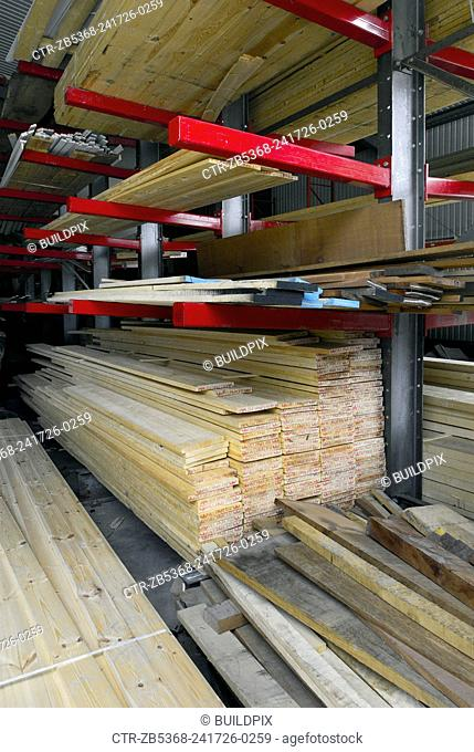 Stacked wood in timber merchant warehouse