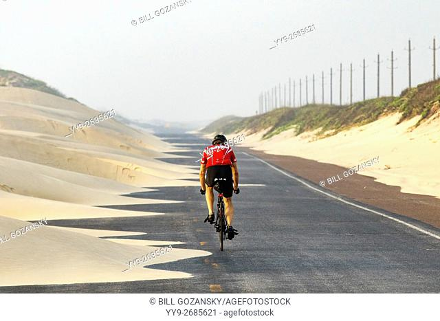 Cyclist on South Padre Island's Park Road 100 - Texas, USA