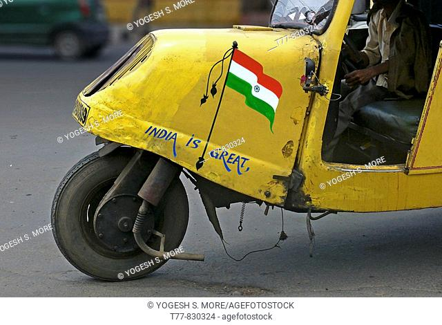 Indian Tricolor Flag painted on a Mad max local transports vehicle along the road Bhopal, Madhyaprsdesh, India