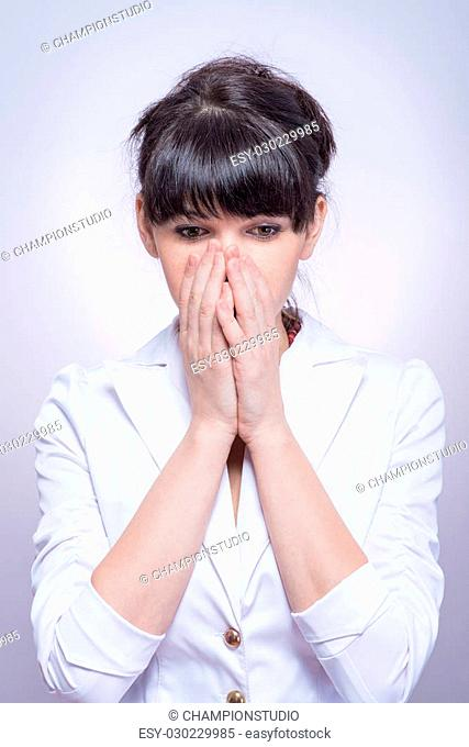 portrait of beautiful shy female stylish woman covering her face