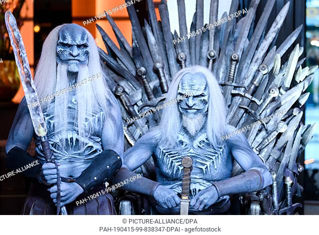 """15 April 2019, Hamburg: Two men dressed up as """"""""White Walkers"""""""", known from the fantasy series """"""""Game of Thrones"""""""", are to be seen in the evening at the..."""