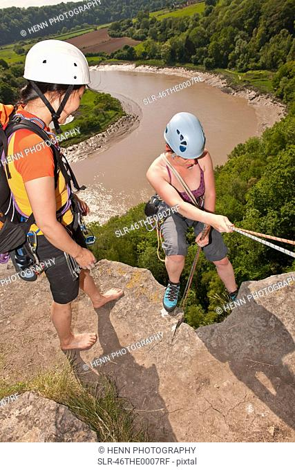 Climbers standing on mountaintop