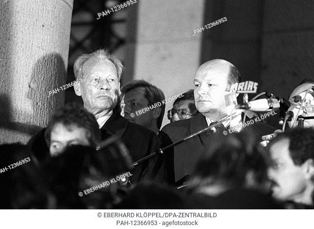 German chancellor Willy Brandt (L) and Berlin lord mayor Walter Mompert (R) pictured during a rally in Berlin, Germany, 10 November 1989