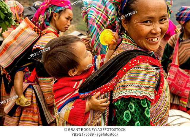 A Mother and Child From The Flower Hmong Hill Tribe At The Ethnic Market In Can Cau, Lao Cai Province, Vietnam