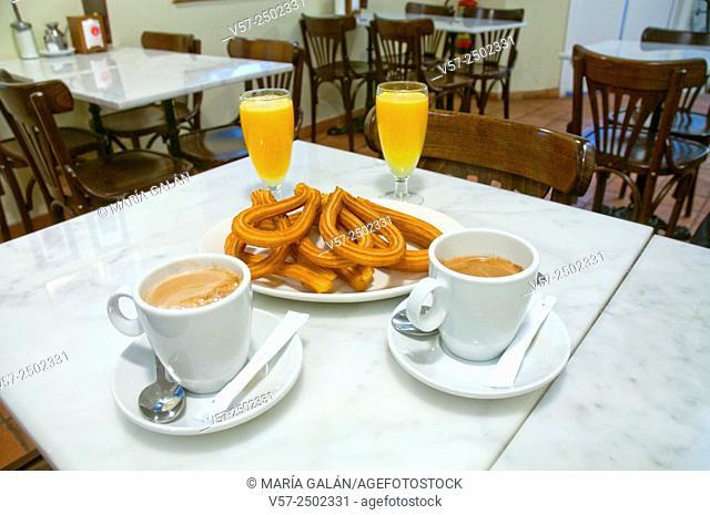 Typical breakfast: churros, coffee and orange juice. Madrid, Spain