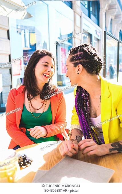 Women on city break at outdoor cafe, Milan, Italy
