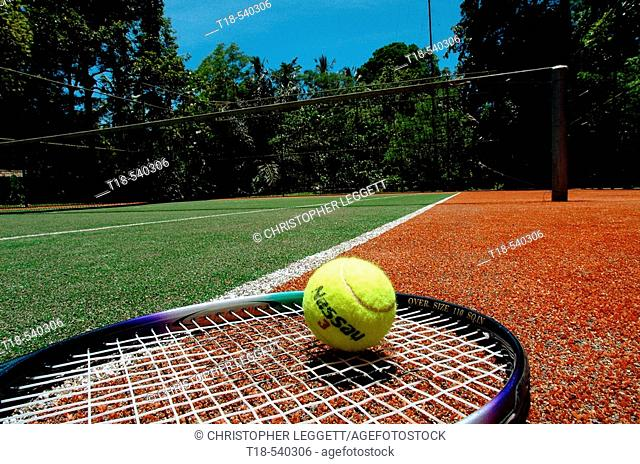 ball and racket in tennis court