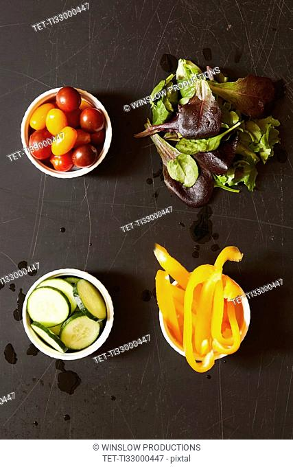 Yellow pepper, tomatoes, cucumber and greens