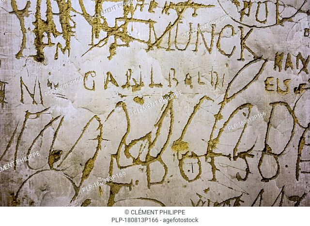 Old graffiti and scratchwork on wall inside the medieval Château de Bouillon Castle, Luxembourg Province, Belgian Ardennes, Belgium