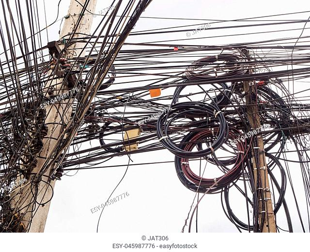 Chaos of cables and wires on electric pole in Chiang Mai,Thailand