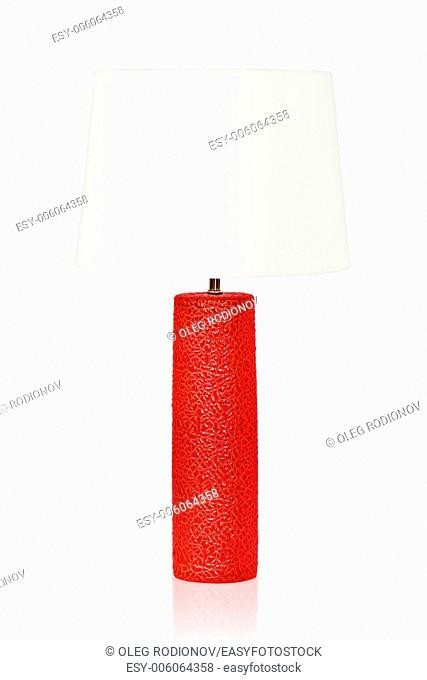 Red table lamp isolated on a white background. Clodeup