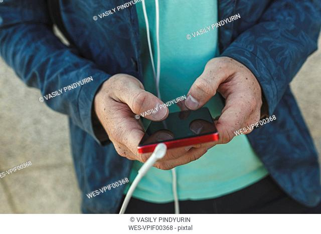 Close-up of man using smartphone
