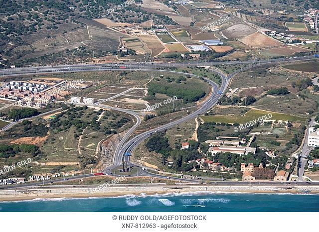 Spain, Catalonia, Barcelona, El Maresme, Montgat. Freeway C-32 (top) and exit to N-II road (bottom)