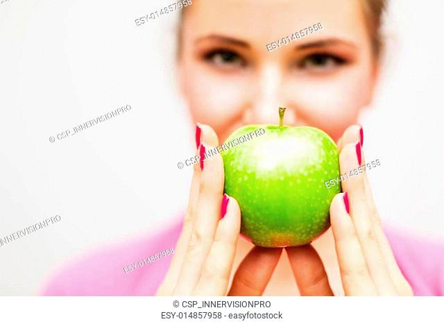 Close up of woman with green apple
