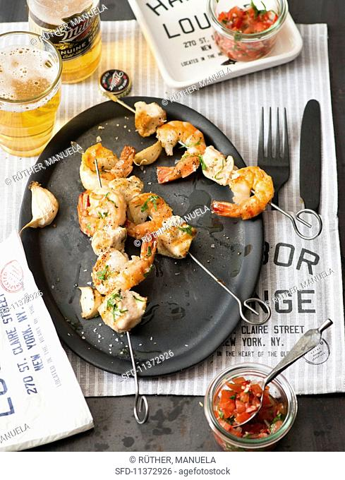 Grilled prawn skewers with salsa in a diner
