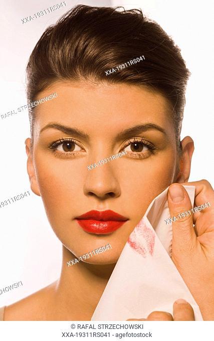 Step 4 - Blotting lips on a tissue