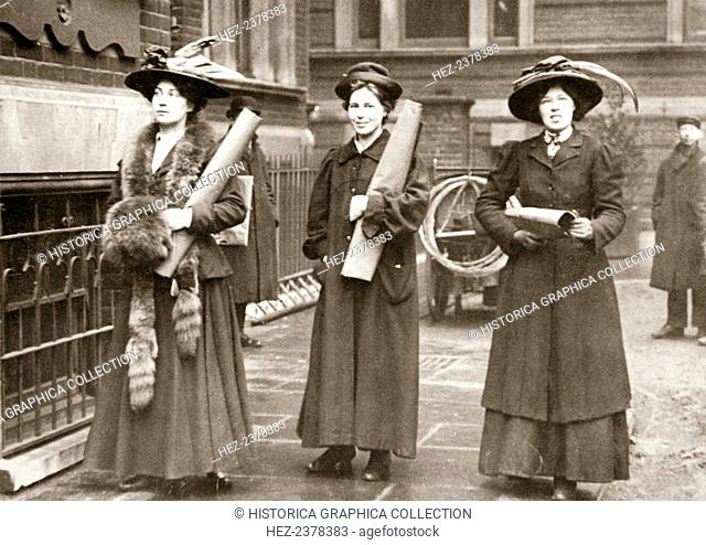 Suffragettes armed with materials to chain themselves to railings, 1909. The Suffragettes found that by chaining themselves to railings they could gain much...