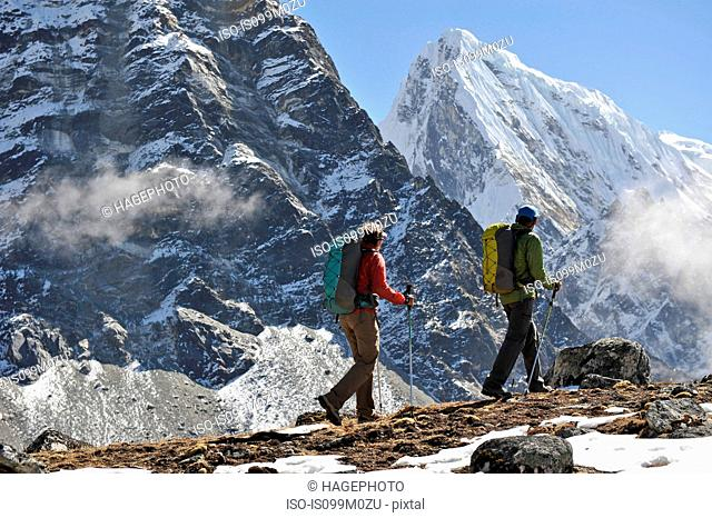 Trekkers hiking along a ridge, Gokyo, Nepal
