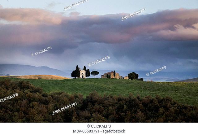 San Quirico d'Orcia, Tuscany, Italy. Sunset over Vitaleta Chapel, with a very cloudy sky