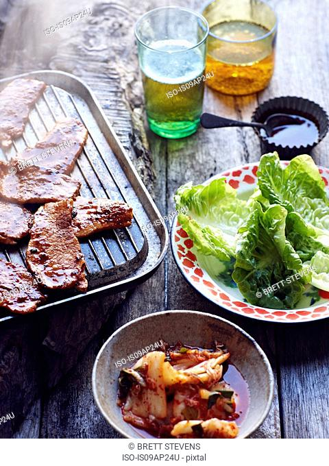 Grilled pork shoulder and salad leaves