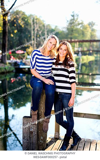 Happy lesbian couple on a jetty