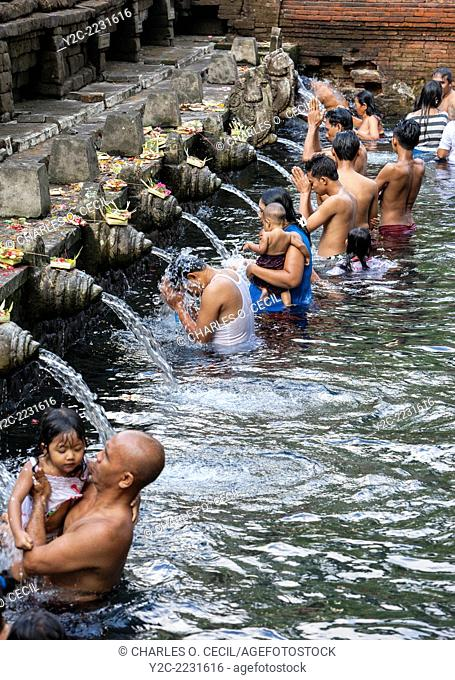 Bali, Indonesia. Worshipers Bathing at Tirta Empul, a Spring Sacred to Balinese Hindus