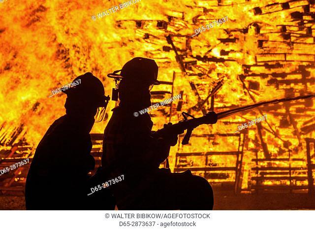 USA, Massachusetts, Cape Ann, Rockport, Fourth of July, firemen at the Rockport Bonfire