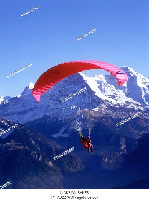 Paragliding from the summit of the Niederhorn Mountain