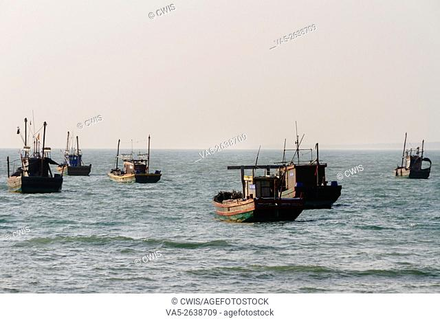 Hainan Island, China - The view of some fishing ships anchoring off the shore
