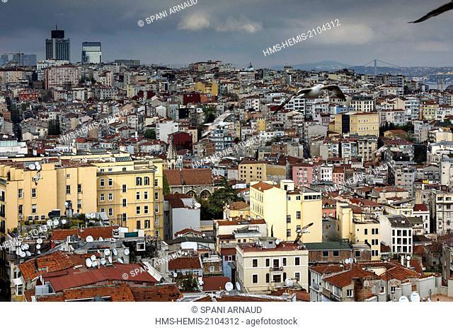 Turkey, Istanbul, Beyoglu, Galata, urban landscape of Istanbul district at sunset on a stormy sky