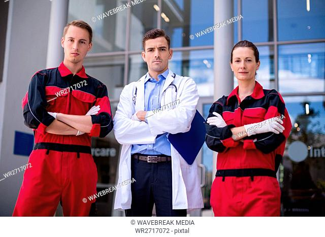Portrait of doctor and paramedic standing with arms crossed