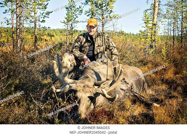 Hunter with dead elk