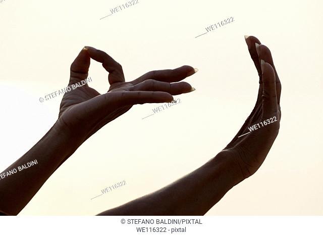 Detail of female forming Mudra hand gesture used in yoga practice meditation