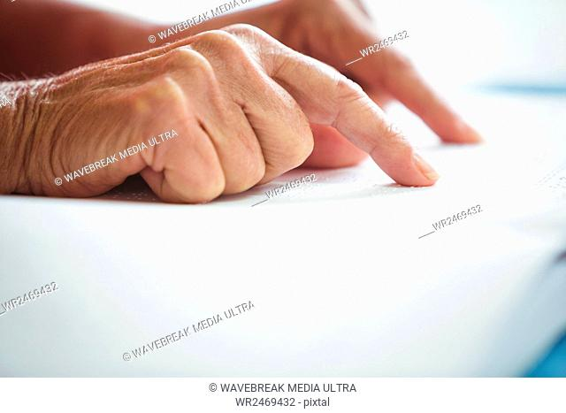 Close-up of two pointing finger on a book