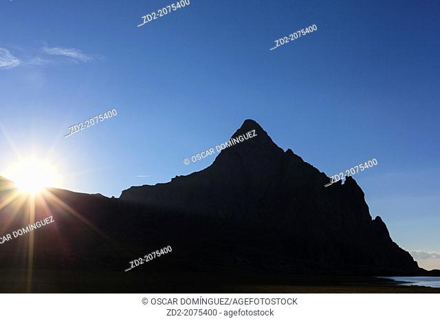Sun on skyline of Anayet peak. Pyrenees. Hesca province. Aragon. Spain