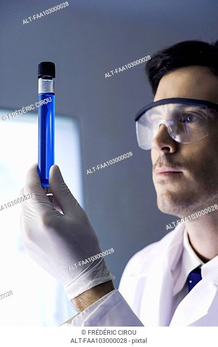 Researcher examining test tube in laboratory