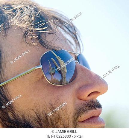 Close up of man wearing sunglasses