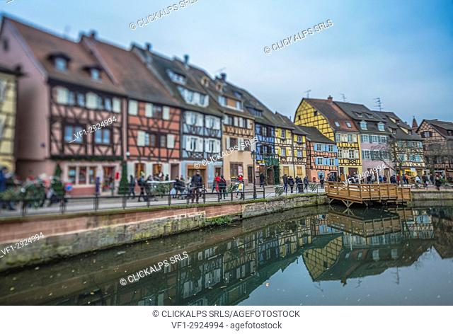 Colored houses reflected in river Lauch at Christmas time Petite Venise Colmar Haut-Rhin department Alsace France Europe