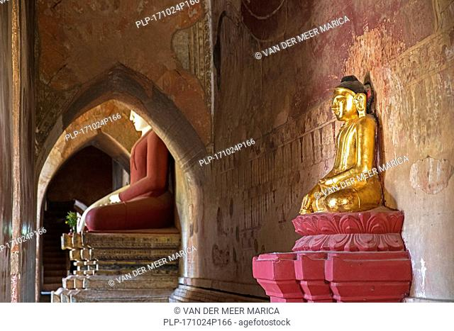 Buddha statues inside the Dhammayangyi Temple, largest Buddhist temple in the ancient city Bagan, Mandalay Region, Myanmar / Burma
