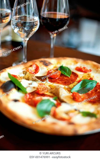 Closeup of freshly baked gourmet pizza at restaurant table