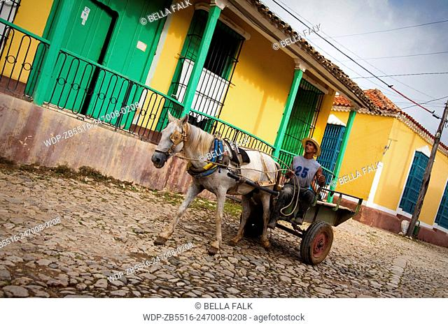 Horse and cart in a colourful street in Trinidad, Cuba