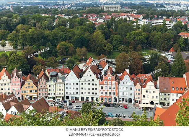 views of typical houses and the streets of the city of landshut from a nearby hill