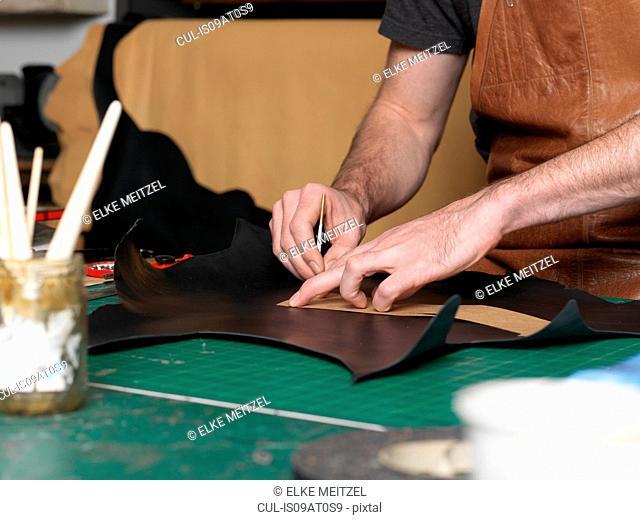 Shoemaker working in workshop
