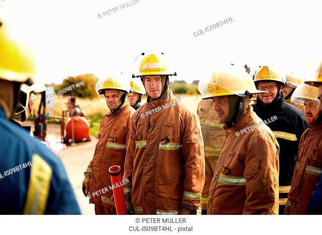 Firemen training, team of firemen listening at meeting at training facility