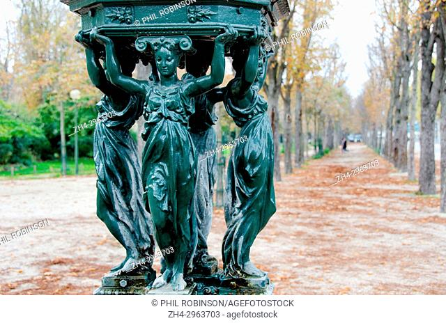 Paris, France. Wallace Fountain on the Avenue des Champs-Élysées - designed by Charles-Auguste Lebourg, named after Richard Wallace