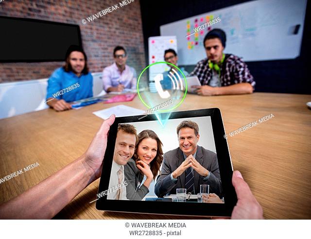 Businespeople having video calling on digital tablet in office