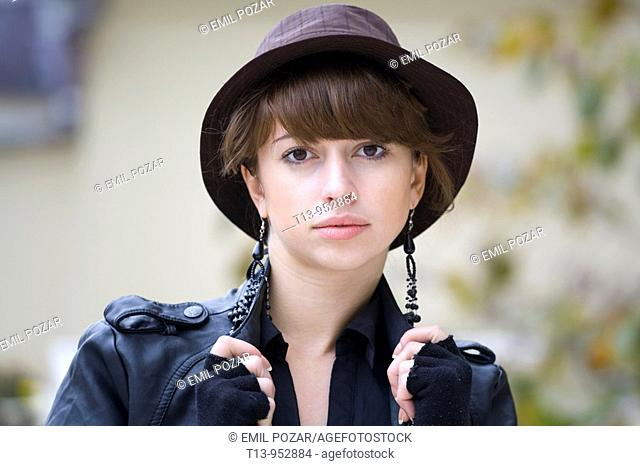 Fancy young woman portrait with stylish hat